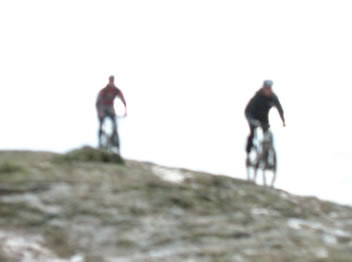 cyclists, snow, hill